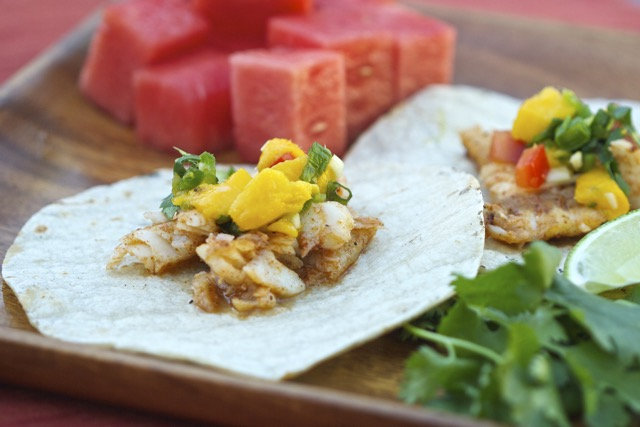 Grilled fish tacos with mango salsa cooking outdoors for How to cook fish tacos